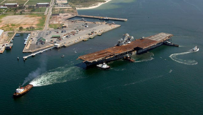 """060515-N-7992K-007Pensacola, Fla. (May 15, 2006) - The decommissioned aircraft carrier USS Oriskany (CVA 34) is towed out to sea one final time. It is planned that the ship will be scuttled 22 miles south of Pensacola in approximately 212 feet of water in the Gulf of Mexico, May 17, 2006, where it will become the largest ship ever intentionally sunk as an artificial reef. After the Oriskany reaches the bottom, ownership of the vessel will transfer from the Navy to the State of Florida. The public will be allowed to fish and dive on the ship two days later. Known as the """"Big O,"""" the 32,000-ton, 888-foot aircraft carrier was built at the New York Naval Shipyard and delivered to the Navy in 1950 where it later became a highly decorated veteran of the Korea and Vietnam conflicts. U.S. Navy photo by PhotographerÕs Mate 2nd Jeffrey P. Kraus (RELEASED)"""