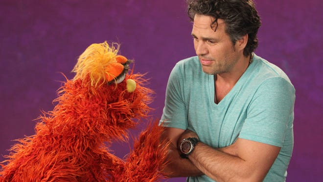 """Actor Mark Ruffalo and """"Sesame Street"""" monster Murray in a scene from a  recent season. The new season will focus on empathy and kindness."""