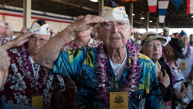 Pearl Harbor survivor Robert Batterson, from Corpus Christi, salutes during the national anthem Wednesday, Dec. 7, 2016, at the 75th Commemoration Event of the attacks on Pearl Harbor and Oahu at Joint Base Pearl Harbor-Hickam in Hawaii.