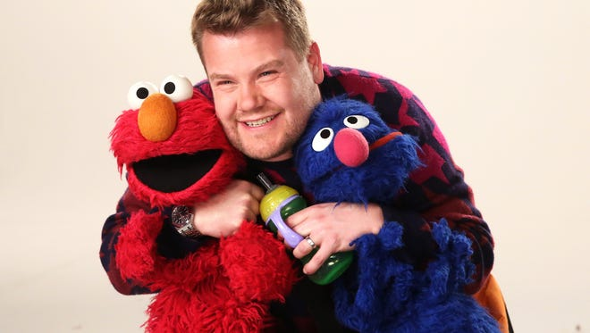 """""""The Late Late Show"""" host James Corden teaches Sesame Street characters about Father's Day in a scene from the show's upcoming 47th season."""