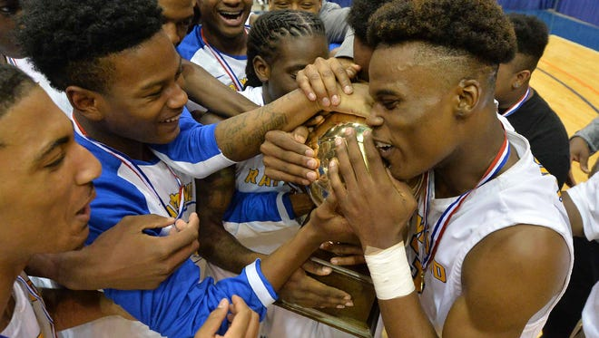 Raymond players celebrate with the trophy following their win against Leake Central during MHSAA 4A Boys Semifinal action held March 9th, 2017 at the Mississippi Coliseum in Jackson, MS. (Bob Smith - For The Clarion Ledger)