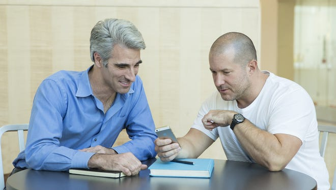 Jony Ive, right, sits with Craig Federighi, Apple's senior vice president of software engineering.