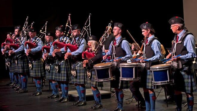 Cincinnati Caledonian Pipes & Drum Band with Karen May, center, soloist, in the Cincinnati Chamber Orchestra's season opener.