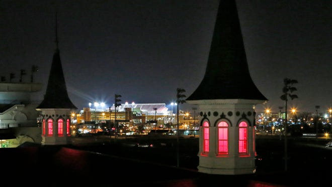 Churchill Downs' Twin Spires were all red Friday evening.