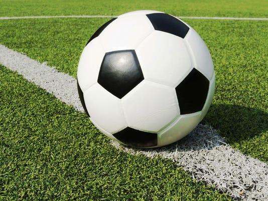 636075097100505755-soccer-ball-turf.jpg