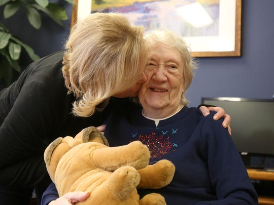 Mischelle Denison of Johnson visits with her mother-in-law, Darlene Denison, 87, on Thursday, Jan. 8, 2015, at the Bishop Drumm Retirement Center in Johnston. Hall, 96, recently recovered from the flu. Darlene is one of many elderly Iowans recovering from or currently battling influenza.