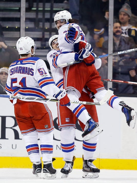 New York Rangers' Mats Zuccarello, of Norway, right, celebrates his goal with teammates Chris Kreider and David Desharnais (51) in overtime during an NHL hockey game against the Boston Bruins in Boston, Saturday, Dec. 16, 2017. The Rangers won 3-2. (AP Photo/Michael Dwyer)
