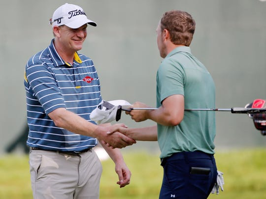 Tom Gillis, left, congratulates Jordan Spieth after their John Deere playoff in 2015.