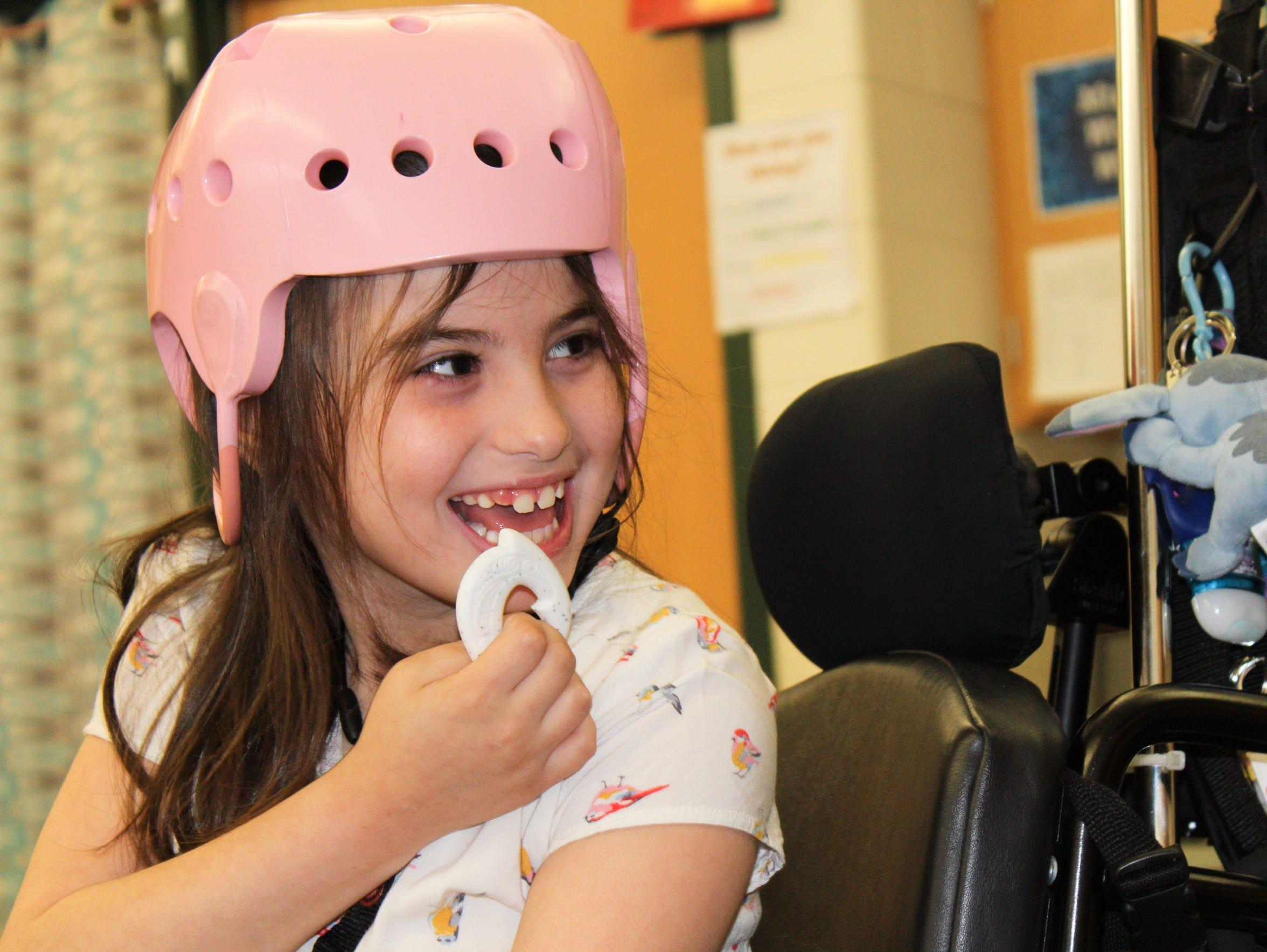 Julianna Shubert, 7, participates in music class at