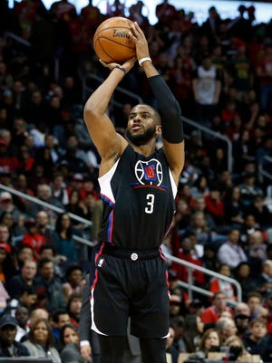 Los Angeles Clippers guard Chris Paul (3) attempts a three-point basket in the first quarter of their game against the Atlanta Hawks at Philips Arena.