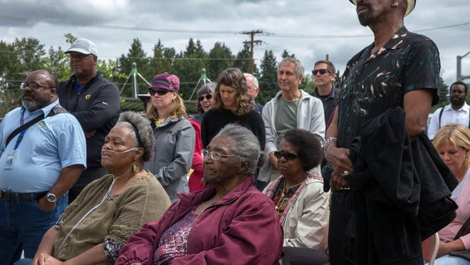 The children of Sam and Mattie Reynolds, including Edward Reynolds (second from left), Lyllye Parker (seated left), Deloris Wilson (seated center), LeVirsei Reynolds (seated right) and Earnest Reynolds (standing right) listen during the Lane Transit District dedication ceremony June 1, 2018 of a historical marker in memory of Sam Reynolds, who was one of Eugene's first African American citizens that settled in west Eugene. [Brian Davies/The Register-Guard file] - registerguard.com