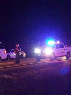 A gunman shot two people and fired multiple rounds at motorists and police vehicles Tuesday night on State Route 87 near Fountain Hills.