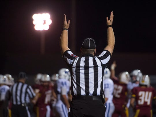 A referee signals a touchdown as the Gibson Southern