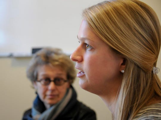 Law student Samantha Lednicky discusses research into racially motivated killings during the mid-20th century. She is a student at the Northeastern University School of Law in Boston. Looking on is professor Rose Zoltek-Jick, deputy director of the Restorative Justice Project.