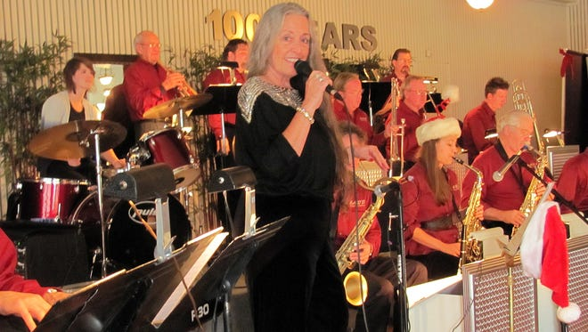 Vocalist Nancy Fischer performs with the Straight Ahead jazz combo.