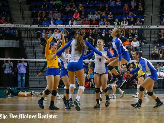 Mackenzie May (No. 3, back to camera) led Dubuque Wahlert to a state volleyball title in 2016. Now she's playing at UCLA.