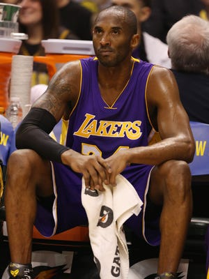 Los Angeles Lakers guard Kobe Bryant (8) is still holding out hope the team gets players to make them more competitive.