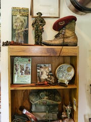 A shelf inside Thurman Mullins' caboose is laden with memorabilia related to his service in the U.S. Marine Corps.