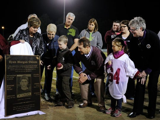 In 2013, Ryan Owens' family takes their first look at the plaque honoring him that was unveiled by then-HCHS principal Sally Sugg, second from left, and then-athletic director Vivian Tomblin, left, during halftime of the Colonels' game against Marshall County. Ryan passed away at the age of 16 while he was a student and athlete at Henderson County High School.