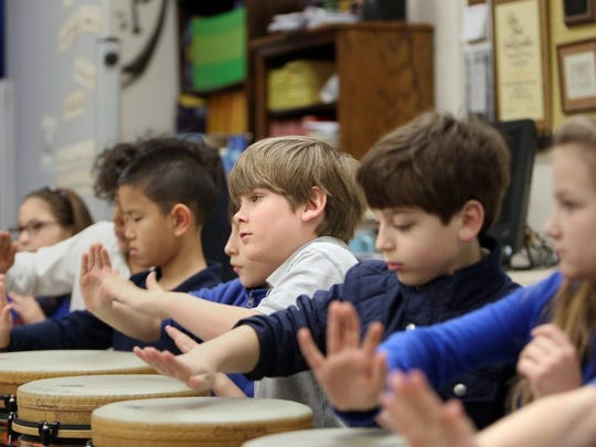 Then -fourth grader Zach Parris (center) plays a tubano during music class at the University of Memphis Campus School in January 2016.