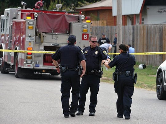Wichita Falls police work the scene of the murder of