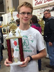 Garnet Henry of Chambersburg won a third-place trophy for showmanship at the Ohio National Poultry Youth Show.