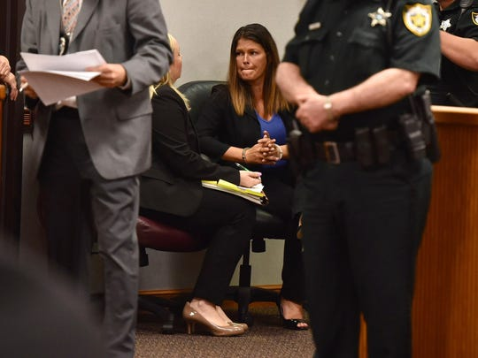 Tiffany Geliga, of Port St. Lucie, who pleaded no contest earlier this year to two counts of sexual assault by someone 24 or older on someone between the ages of 16 and 17, sits with her attorney after being sentenced by Judge Gary Sweet on Tuesday, May 29, 2018, at the St. Lucie County Courthouse in Fort Pierce.
