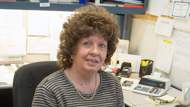 Kathy Myers, circulation manager for The News Leader, will retire Dec. 24 after 36 years at the newspaper. She's seen in her office Wednesday, Dec. 7, 2016, behind a shelf full of awards her department has received for superior customer service.