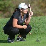 Novi's Alexa Hatz, who was runner-up at the regional with a 73, lines up a putt at Hartland Glen.