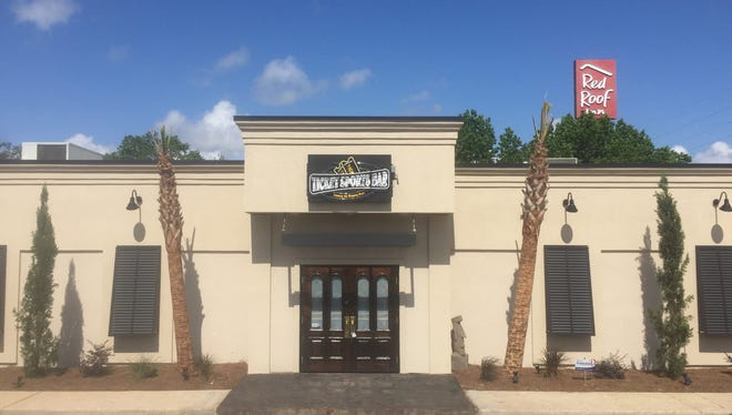The Ticket Sports Bar will celebrate the grand opening of its new location at 7333 N. Davis Highway on Friday.