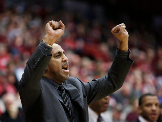 Washington head coach Lorenzo Romar directs his team during the first half of an NCAA college basketball game against Washington State in Pullman, Wash., Sunday, Feb. 26, 2017. (AP Photo/Young Kwak)