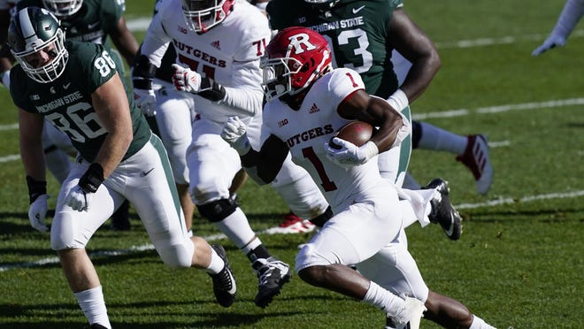 Rutgers running back Isaih Pacheco (1) rushes during the first half of an NCAA college football game against Michigan State, Saturday, Oct. 24, 2020, in East Lansing, Mich.