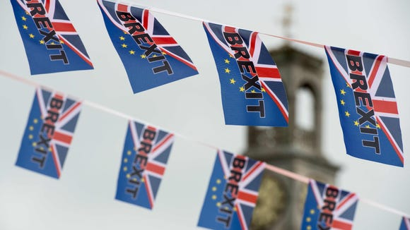 Pro-Brexit flags fly from a fishing boat moored in