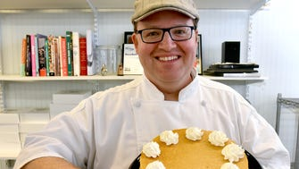 Campbell's Bakery owner/chef Mitchell Moore shows off his pumpkin pie cheesecake.