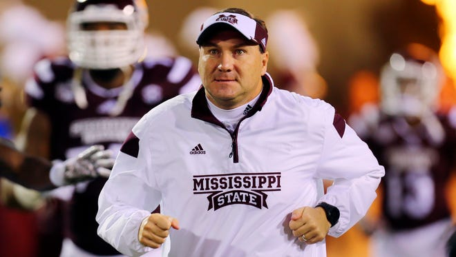 Mississippi State coach Dan Mullen will compete in his first marathon on Monday in Boston.