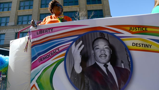 Dr. Martin Luther King Jr. is honored on this float in the 2015 parade in downtown Pensacola.