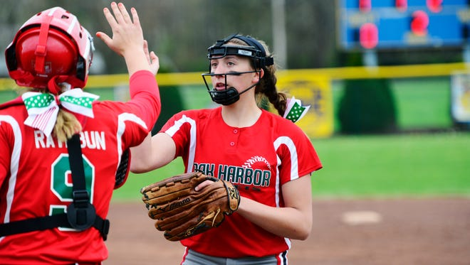 Oak Harbor's Ashley Riley, right, and Maddy Rathbun return to form an imposing battery.