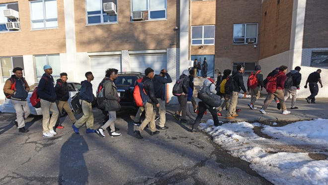 The Kennedy High School basketball team arrives at Eastside High School for Tuesday's game, which was closed to the general public.