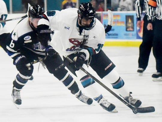 Shreveport's Gabe Wahl skates away from a Brahmas defender during Thursday's game.