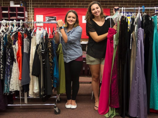 Riverdale High School junior IB students Brittany Cruz, left, and Taylor Bristol organized a prom dress drive to help out their fellow students.