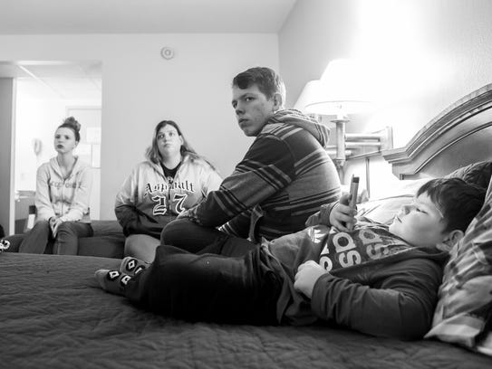 Melody Ramsburg, second from left, lives in this room at Cross Keys Motor Inn with her youngest child, James, 4, far right. Melody's two other children, Kiana Shifflett, 17, and Zachary Shifflett, 15, are students at the Milton Hershey School, a cost-free, private boarding school for low-income families.