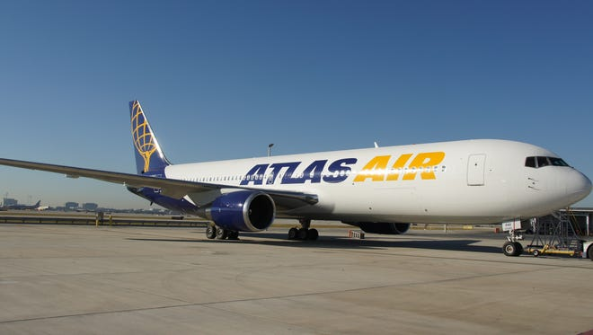 A Boeing 767 cargo jet owned by Atlas Air. Amazon leased 20 of the jets on May 5, 2016 to further build out its air cargo network. It also will take as much as a 20% stake in the company.