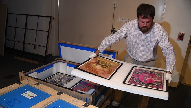 "Farmington Museum Curator Jeffrey Richardson unpacks concert posters for the upcoming exhibition ""Technicolor Dreaming: Psychedelic Posters from the Rock and Roll Hall of Fame"" opening this weekend at the musem."