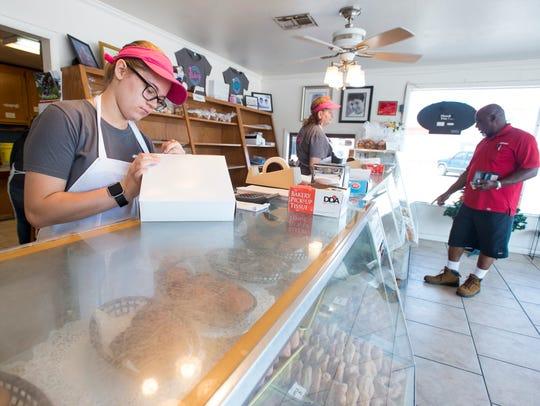 Emily Reagin, left, prepares a customer's order at