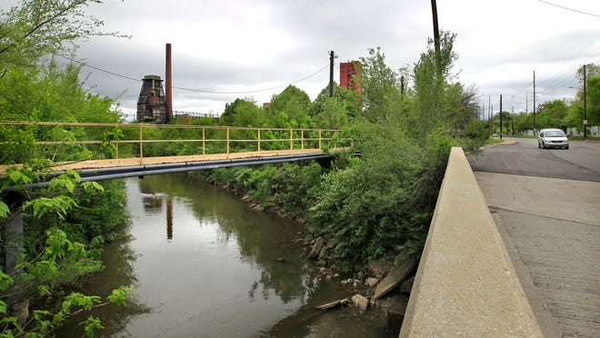 Pleasant Run Creek (shown May 15, 2014) exits the property of the old Indianapolis Coke plant (background), 2950 Prospect St.