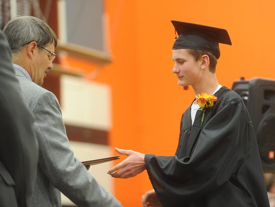 Shawn Chase receives his diploma during the Class of