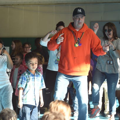 Beacon principal leads students in 'Juju' dance for charity