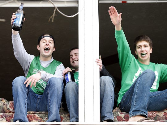 Miami University students celebrate Green Beer Day from the Bagel and Deli Shop on High Street in Oxford in 2011.