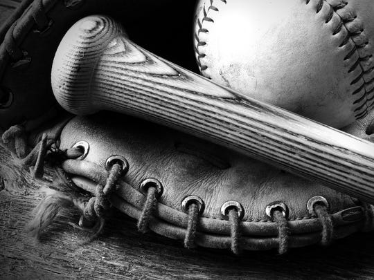 A black and white image of an old baseball glove and