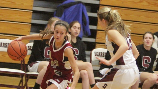 Albertus Magnus' Danielle LaRochelle attempts to get around Scarsdale's Alexis Kline during a girls basketball game at Scarsdale High School on Tuesday, February 9th, 2016. Albertus Magnus won 54-48.